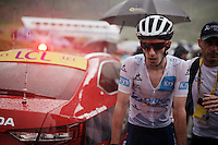 white jersey Adam Yates (GBR/Orica-BikeExchange) being escorted towards the podium ceremony after the soaking finale of stage 9 in Andorra Arcalis (coming from Velha Val d'Aran/ESP, 184km)<br /> <br /> 103rd Tour de France 2016