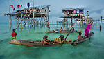 Bajau seaborne settlement, Semporna, Sabah, Malaysia<br /> Sometimes called sea gypsies, the Bajau have little allegiance to any country.  They distrust Malaysia, the Philippines, and Indonesia.  They live in boats and small stilted homes.  They are fishermen and speak their own language.