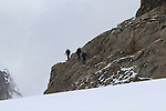 Mountain climbers descending the Monk, above Lauterbrunnen, Switzerland.