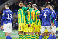 Kyle Bartley of West Bromwich Albion (2nd L) communicates with his goalkeeper before a free kick by Lee Tomlin of Cardiff City during the Sky Bet Championship match between Cardiff City and West Bromwich Albion at the Cardiff City Stadium, Cardiff, Wales, UK. Tuesday 28 January 2020