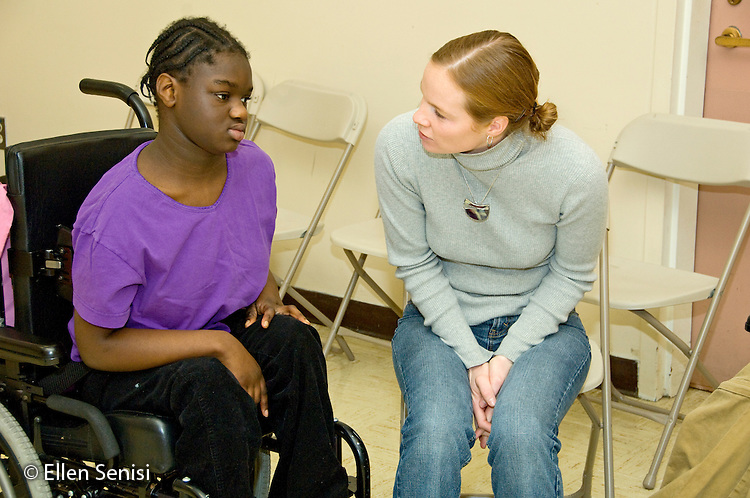 MR / Albany, NY.Langan School at Center for Disability Services .Ungraded private school which serves individuals with multiple disabilities.Teaching assistant interacts with non-verbal student. Girl: 10, African-American, cerebral palsy, expressive and receptive language delays.MR: Neu1, And6.© Ellen B. Senisi
