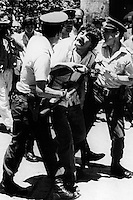 Photographer Juan Carlos Caceres is arrested by police during a protest against Pinoche dictatorship in 1986<br /> <br /> Forty years ago, on September 11, 1973, a military coup led by General Augusto Pinochet toppled the democratic socialist government of Chile. President Salvador Allende was killed during the  attack to seize  La Moneda presidential palace.  In the aftermath of the coup, a quarter of a million people were detained for their political beliefs, 3000 were killed or disappeared and many thousands were tortured.<br /> Some years later in 1981, while Pinochet ruled Chile with iron fist, a young photographer called Juan Carlos Caceres started to freelance in the streets of Santiago and the poblaciones or poor outskirts, showing the growing resistance against the dictatorship. For the next 10 years Caceres photographed every single protest and social movement fighting for the restoration of democracy. He knew that his camera was his only weapon, he knew that his fate was to register the daily violence and leave his images for the History.<br /> In this days Caceres is working to rescue and organize his collection of images in the project Imagenes de la Resistencia   . With support of some Chilean official institutions, thousands of negatives are digitalized and organized to set up the more complete visual heritage of this  violent period of Chile´s history.