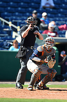 Umpire Sean Barber makes a call behind Cal State Fullerton Titans catcher A.J. Kennedy (10) during a game against the Louisville Cardinals on February 15, 2015 at Bright House Field in Clearwater, Florida.  Cal State Fullerton defeated Louisville 8-6.  (Mike Janes/Four Seam Images)