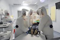 - Milano (Italy), hospital Sacco, maximum isolation unit for infectious diseases, nurses with protective garments<br /> <br /> - Milano (Italia), ospedale Sacco, reparto di massimo isolamento per le malattie infettive, infermiere con indumenti protettivi