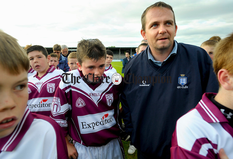 David Fitzgerald, joins with his son Colm and the rest of Colm's Doora Barefield team a Hurling final at Cusack park. Photograph by John Kelly.