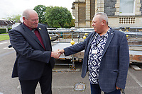 LEGAL NOTICE: THERE IS NOW A COURT ORDER PREVENTING THE IDENTIFICATION OF DANIELLE JOHN AND ANY PUBLICATION OF HER PICTURES Pictured L-R: Byron John, Bradley's father is greeted by Councillor Rob Evans after the verdict at the Coroner's Court in Llanelli, Wales, UK. Tuesday 29 June 2021<br /> Re: A verdict for a Coroner's inquest into the death of 14 year old Bradley John, who was found dead by his sister at his school, has been read out at the Coroner's Court in Llanelli, Wales, UK.<br /> Talented young horse rider Bradley John, 14, was found hanged in the school toilets by his younger sister Danielle (DANIELLE JOHN CANNOT BE IDENTIFIED AND/OR NAMED) at the 500-pupils St John Lloyd Roman Catholic school in Llanelli, South Wales in September 2018.<br /> Bradley's family claim he had been bullied for two years after being diagnosed with Attention Deficit Hyperactivity Disorder.<br /> He went missing during lessons and was found in the toilet cubicle by his sister Danielle (DANIELLE JOHN CANNOT BE IDENTIFIED AND/OR NAMED), who was 12 at the time.