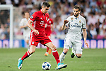 Robert Lewandowski (l) of FC Bayern Munich battles for the ball with Nacho Fernandez of Real Madrid during their 2016-17 UEFA Champions League Quarter-finals second leg match between Real Madrid and FC Bayern Munich at the Estadio Santiago Bernabeu on 18 April 2017 in Madrid, Spain. Photo by Diego Gonzalez Souto / Power Sport Images