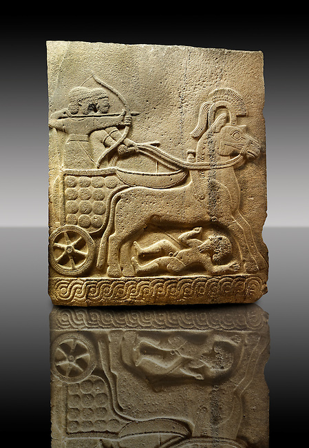 Picture & image of a Neo-Hittite orthostat with a chariot Releif sculpture from Karkamis,, Turkey. Museum of Anatolian Civilisations, Ankara. The Cahiot is pulled by horses with plumed headresses. One man os about to shoot an arrow from his bow, the other man is driving the cahriot. Below the horse is a man dying. 1