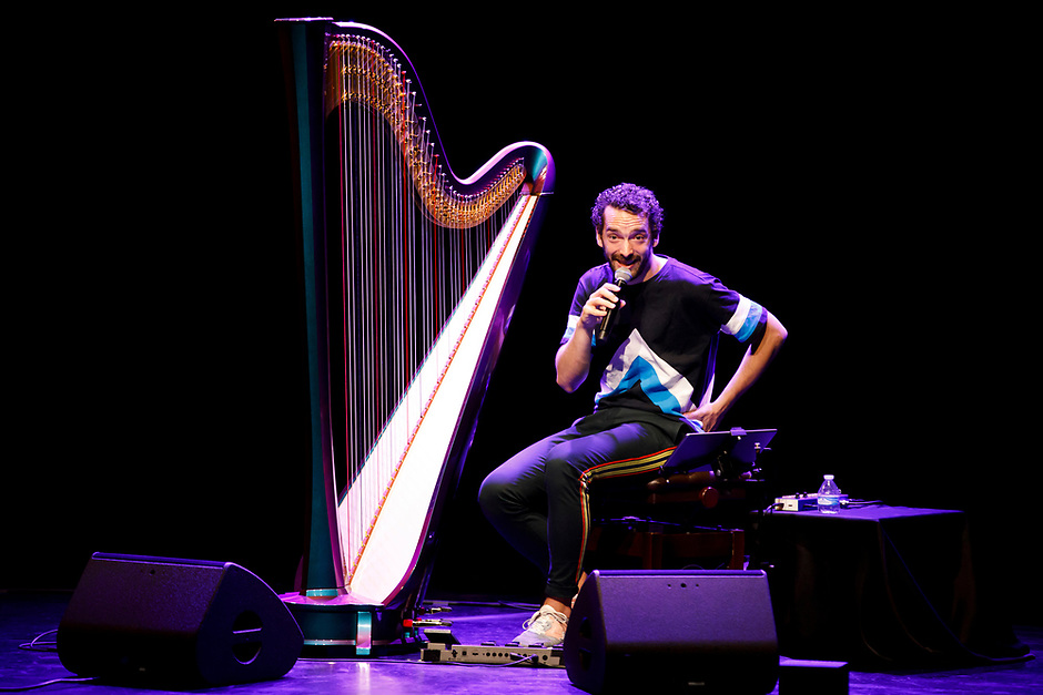 Remy van Kesteren speaks to the audience during his laureate recital at the 11th USA International Harp Competition at the Buskirk-Chumley Theater in Bloomington, Indiana on Saturday, July 6, 2019. (Photo by James Brosher)