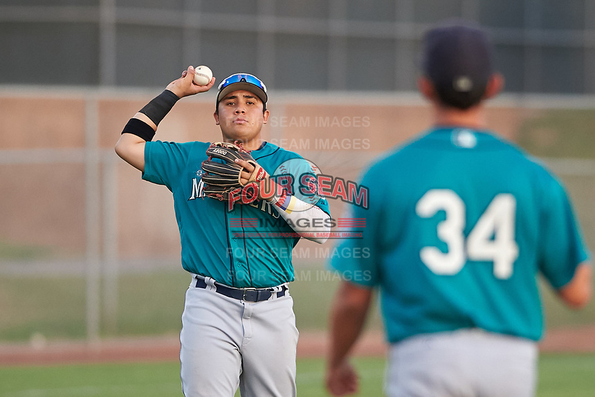 AZL Mariners third baseman Nolan Perez (5) throws the ball to pitcher Brayan Perez (34) during an Arizona League game against the AZL Giants Orange on July 18, 2019 at the Giants Baseball Complex in Scottsdale, Arizona. The AZL Giants Orange defeated the AZL Mariners 7-4. (Zachary Lucy/Four Seam Images)