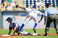 Andrew Garcia #6 of the Charlotte Knights is tagged out at second base by Durham Bulls shortstop Tim Beckham #22 at Durham Bulls Athletic Park on August 28, 2011 in Durham, North Carolina.   (Brian Westerholt / Four Seam Images)
