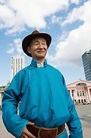 Mongolia, Ulaanbaatar. Man in Sukhbaatar Square.