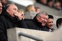 FAO SPORTS PICTURE DESK<br /> Pictured: Manchester United manager Sir Alex Ferguson (R) watching the game from the directors' box. Saturday, 28 April 2012<br /> Re: Premier League football, Swansea City FC v Wolverhampton Wanderers at the Liberty Stadium, south Wales.