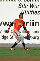 Aberdeen IronBirds outfielder Jamill Moquete (9) tracks down a fly ball during a game against the Williamsport Crosscutters on August 4, 2014 at Bowman Field in Williamsport, Pennsylvania.  Aberdeen defeated Williamsport 6-3.  (Mike Janes/Four Seam Images)