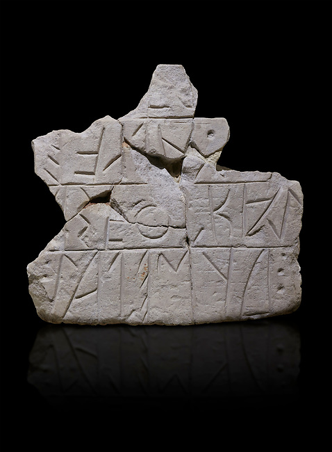 Stone stele fragment with a Phrygian written inscription. From Grodion . Phrygian Collection, 8th-7th century BC - Museum of Anatolian Civilisations Ankara. Turkey. Against a black background