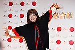"""Dec. 29, 2009 - Enka singer, Mitsuko Nakamura, poses for photographers during the first day of rehearsals for 'Kohaku Uta Gassen,' or also more commonly known as 'Kohaku.' Produced by the Japanese public broadcaster, NHK, this annual music show airs on New Year's Eve and ends shortly before midnight, where everyone on air pauses to say """"Happy New Year."""" The 'Red and White Song Battle' separates the most popular music artists during each given year into teams of red and white: the red team consists of all female artists and the white team is all male artists. For an artist to perform on Kohaku, it is a great honor as only the most successful enka singers and J-Pop artist are strictly invited to perform by invitation only. Today, for a J-Pop artist or enka singer to perform on Kohaku, is most notably recognized to be a big highlight in a singer's career due to the show's large reach of audience during New Year's Eve."""