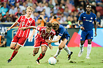 Bayern Munich Forward Kingsley Coman (C) fights for the ball with Chelsea Defender Marcos Alonso (R) during the International Champions Cup match between Chelsea FC and FC Bayern Munich at National Stadium on July 25, 2017 in Singapore. Photo by Weixiang Lim / Power Sport Images