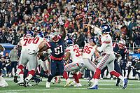 FOXBORO, MA - OCTOBER 10: New York Giants Quarterback Daniel Jones (8) passes as New England Patriots Linebacker Ja'Whaun Bentley (51) tries to block during a game between New York Giants and New England Patriots at Gillettes on October 10, 2019 in Foxboro, Massachusetts.