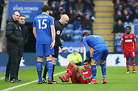 Referee Anthony Taylor checks Kyle Naughton of Swansea is okay during the Premier League match between Leicester City and Swansea City at the King Power Stadium, Leicester, England, UK. Saturday 03 February 2018