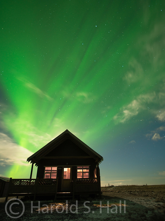 This is our rental cabin for the night.  We had already had concluded our wine and hot tubing for the evening when Katie spotted the Northern Lights dancing above us.  The light behind the cabin is the full moon.