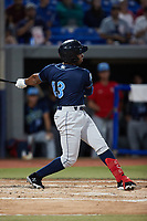 Omar Meregildo (13) of the Wilmington Blue Rocks follows through on his swing against the Hudson Valley Renegades at Dutchess Stadium on July 27, 2021 in Wappingers Falls, New York. (Brian Westerholt/Four Seam Images)