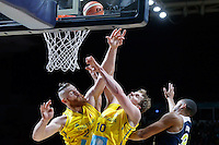 July 12, 2016: ARON BAYNES (12) and CAMERON BAIRSTOW (10) of Australia jump for the ball during game 1 of the Australian Boomers Farewell Series between the Australian Boomers and the American PAC-12 All-Stars at Hisense Arena in Melbourne, Australia. Sydney Low/AsteriskImages.com