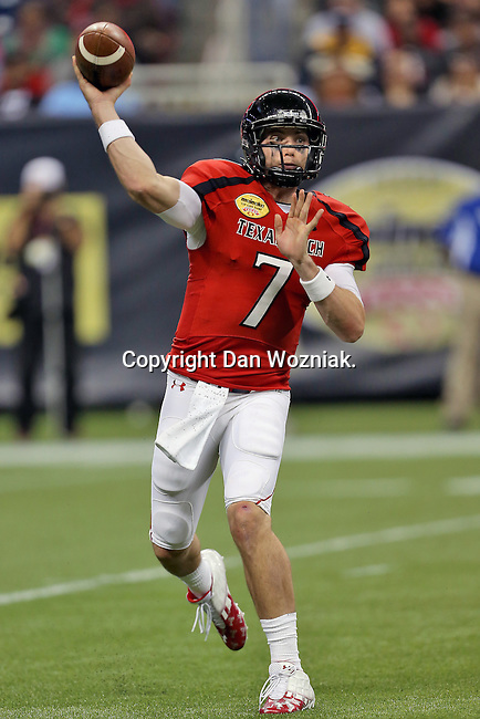 Texas Tech Red Raiders quarterback Seth Doege (7) in action during the Meineke Car Care Bowl game of Texas between the Texas Tech Red Raiders and the Minnesota Golden Gophers at the Reliant Stadium in Houston, Texas. Texas defeats Minnesota 34 to 31.