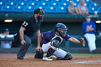 Catcher Max Soliz (25) of Bob Jones HS in Madison, AL playing for the Colorado Rockies scout team playing for the Colorado Rockies scout team sets a target as home plate umpire Will Posey looks on during the East Coast Pro Showcase at the Hoover Met Complex on August 3, 2020 in Hoover, AL. (Brian Westerholt/Four Seam Images)