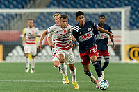 FOXBOROUGH, MA - AUGUST 21: Damian Rivera #72 of New England Revolution II brings the ball forward as Victor Falck #23 of Richmond Kickers defends during a game between Richmond Kickers and New England Revolution II at Gillette Stadium on August 21, 2020 in Foxborough, Massachusetts.