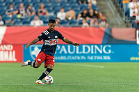 FOXBOROUGH, MA - AUGUST 18: A.J. DeLaGarza #28 of New England Revolution passes the ball during a game between D.C. United and New England Revolution at Gillette Stadium on August 18, 2021 in Foxborough, Massachusetts.
