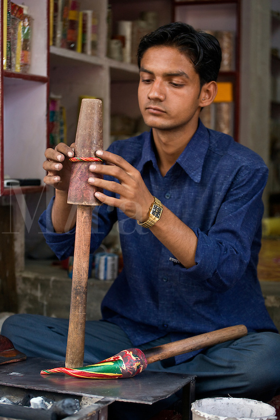 A CRAFTSMAN makes a traditional BRACELET from  RESIN - JOHDPUR, RAJASTHAN, INDIA