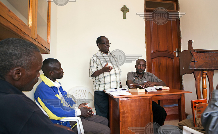 79 year old Bishop Christopher Senyonjo talking with gay rights activists in an office at his church.  Parts of the Ugandan church and media have been campaigning against homosexuals and lesbians.