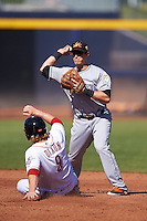 Mesa Solar Sox Austin Nola (8), of the Miami Marlins organization, throws to first as Brandon Dixon (9) slides into second base during a game against the Peoria Javelinas on October 19, 2016 at Peoria Stadium in Peoria, Arizona.  Peoria defeated Mesa 2-1.  (Mike Janes/Four Seam Images)