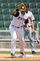 First baseman Christian Marrero (24) of the Kannapolis Intimidators fields a throw versus the Hagerstown Suns at Fieldcrest Cannon Stadium in Kannapolis, NC, Monday May 26, 2008.