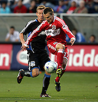 Chicago forward Chris Rolfe (17) receives the ball in front of San Jose defender Chris Leitch (4).  The Chicago Fire defeated the San Jose Earthquakes 2-0 at Toyota Park in Bridgeview, IL on July 18, 2009.