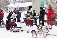 Saturday, March 3, 2012 Bruce Linton high fives children at the Ceremonial Start of Iditarod 2012 in Anchorage, Alaska.