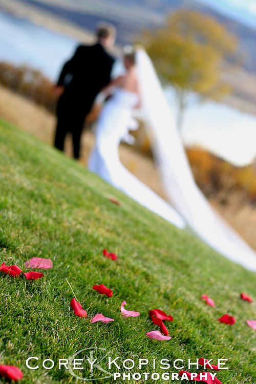 Bride and groom dashing off for a little silence after ceremony at a Colorado wedding.