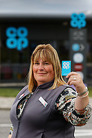 Store manager Louise Hughes with the Co op loyalty card.
