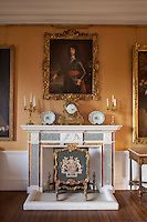 A copy of a painting of Charles II painted by Philippe de Champaigne, c. 1653, hangs above the dining room fireplace