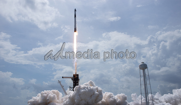 In this photo released by the National Aeronautics and Space Administration (NASA), a SpaceX Falcon 9 rocket carrying the company's Crew Dragon spacecraft is launched from Launch Complex 39A on NASA's SpaceX Demo-2 mission to the International Space Station with NASA astronauts Robert Behnken and Douglas Hurley onboard, Saturday, May 30, 2020, at NASA's Kennedy Space Center in Florida. The Demo-2 mission is the first launch with astronauts of the SpaceX Crew Dragon spacecraft and Falcon 9 rocket to the International Space Station as part of the agency's Commercial Crew Program. The test flight serves as an end-to-end demonstration of SpaceX's crew transportation system. Behnken and Hurley launched at 3:22 p.m. EDT on Saturday, May 30, from Launch Complex 39A at the Kennedy Space Center. A new era of human spaceflight is set to begin as American astronauts once again launch on an American rocket from American soil to low-Earth orbit for the first time since the conclusion of the Space Shuttle Program in 2011. <br /> Mandatory Credit: Bill Ingalls / NASA via CNP/AdMedia