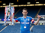 Rangers captain Lee Wallace lifts the championship trophy