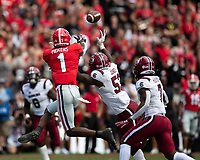 ATHENS, GA - OCTOBER 12: George Pickens #1 of the Georgia Bulldogs makes a reception over Ernest Jones #53 of the South Carolina Gamecocks during a game between University of South Carolina Gamecocks and University of Georgia Bulldogs at Sanford Stadium on October 12, 2019 in Athens, Georgia.