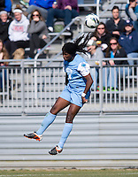 Satara Murray (44) of North Carolina heads the ball during the game at the Maryland SportsPlex in Boyds, MD.  The Washington Spirit defeated the North Carolina Tar Heels in a preseason exhibition, 2-0.