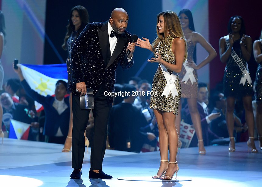 BANGKOK, THAILAND - DECEMBER 17:   Host Steve Harvey and Miss Costa Rica Naalia Carvajal at the 2018 MISS UNIVERSE competition at the Impact Arena in Bangkok, Thailand on December 17, 2018. (Photo by Frank Micelotta/FOX/PictureGroup)