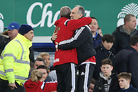 Swansea City Head Coach Francesco Guidolin celebrates victory with Swansea City Interim Manager / First Team Coach Alan Curtis at the final whistle in the Barclays Premier League match between Everton and Swansea City played at Goodison Park, Liverpool