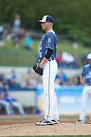 West Michigan Whitecaps starting pitcher Matt Manning (16) looks to his catcher for the sign against the South Bend Cubs at Fifth Third Ballpark on June 10, 2018 in Comstock Park, Michigan. The Cubs defeated the Whitecaps 5-4.  (Brian Westerholt/Four Seam Images)