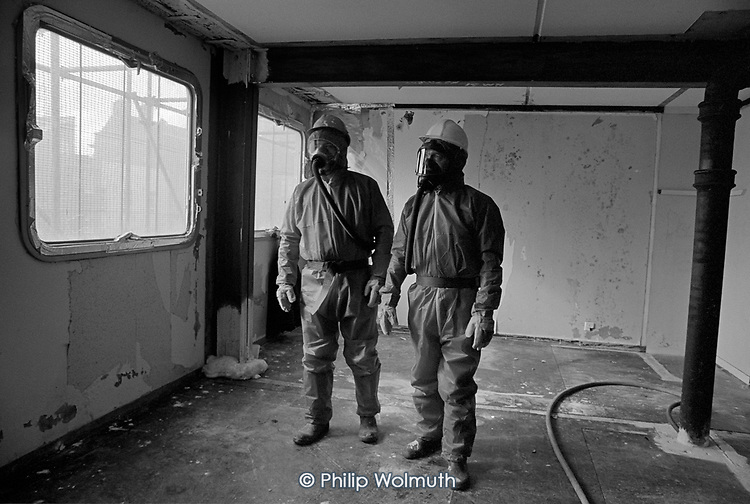 Workers prepare to remove asbestos from a flat in Chantry Point, before demolition of the twenty storey block on Elgin Estate in North Paddington, London.  The building had previously been used by Westminster City Council to house homeless families, a spin-off from its illegal 'Designated Sales' policy, also known as the 'Homes for Votes' scandal.