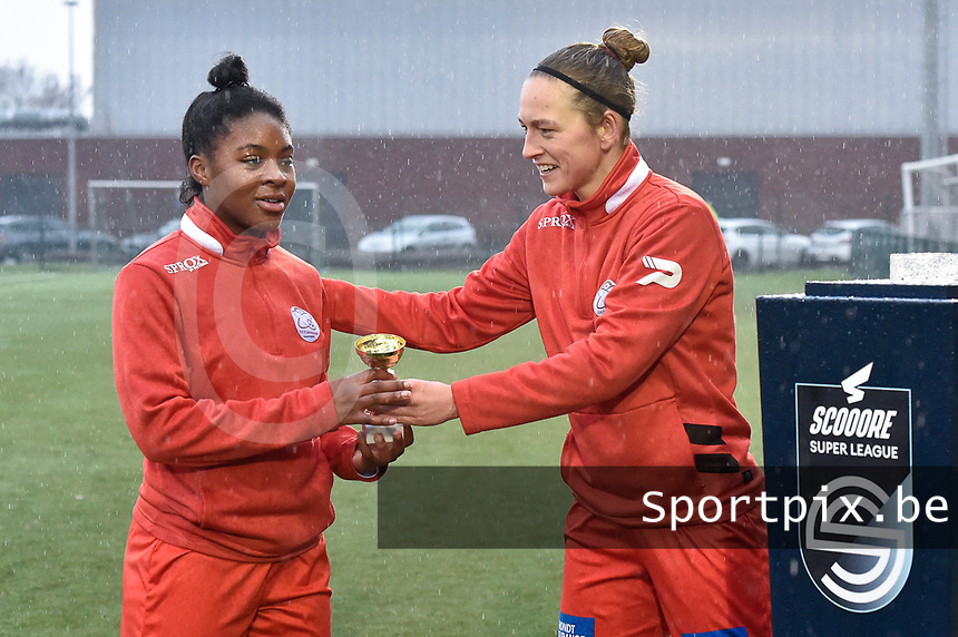"Esther Buabadi (24) of Zulte-Waregem  pictured receiving the trophee ""Player of the Month December"" out of hand of Pauline Windels (5) of Zulte-Waregem before a female soccer game between SV Zulte - Waregem and Sporting Charleroi on the eleventh matchday of the 2020 - 2021 season of Belgian Scooore Womens Super League , saturday 23 th of January 2021  in Zulte , Belgium . PHOTO SPORTPIX.BE 