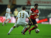 Pictured: Ben Davies of Swansea (L). Tuesday 28 August 2012<br /> Re: Capital One Cup game, Swansea City FC v Barnsley at the Liberty Stadium, south Wales.