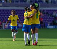 ORLANDO, FL - FEBRUARY 18: Marta #10 of Brazil celebrates with Beatriz #16 during a game between Argentina and Brazil at Exploria Stadium on February 18, 2021 in Orlando, Florida.